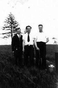 Vintage photo of 3 tour guides.